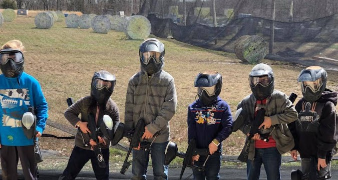 youth group playing low impact paintball