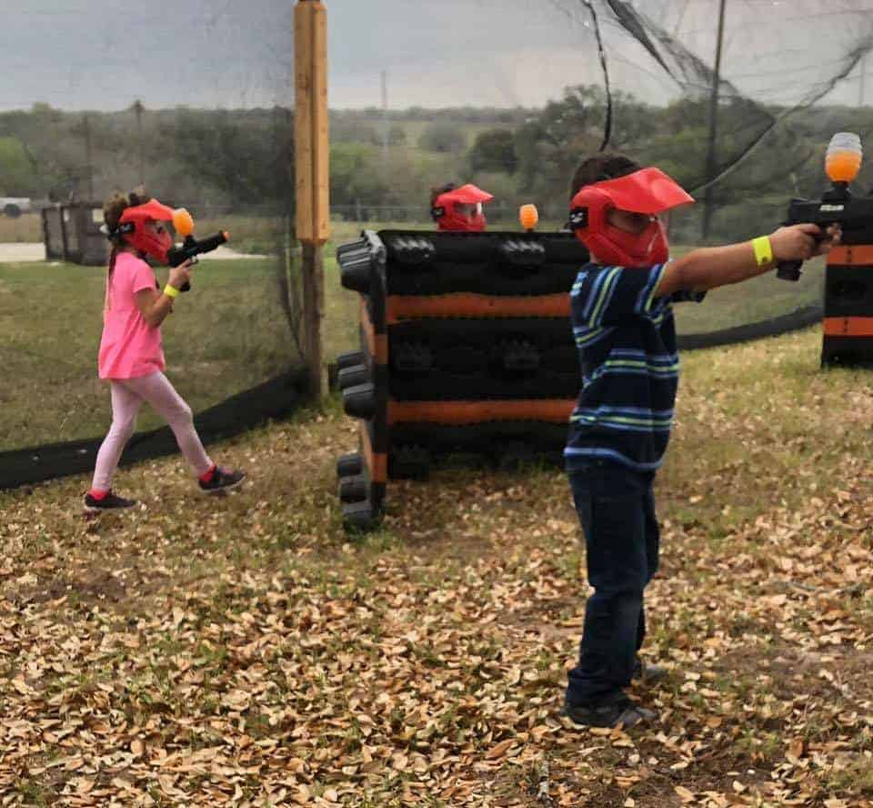 boy and girl shooting gellyball guns